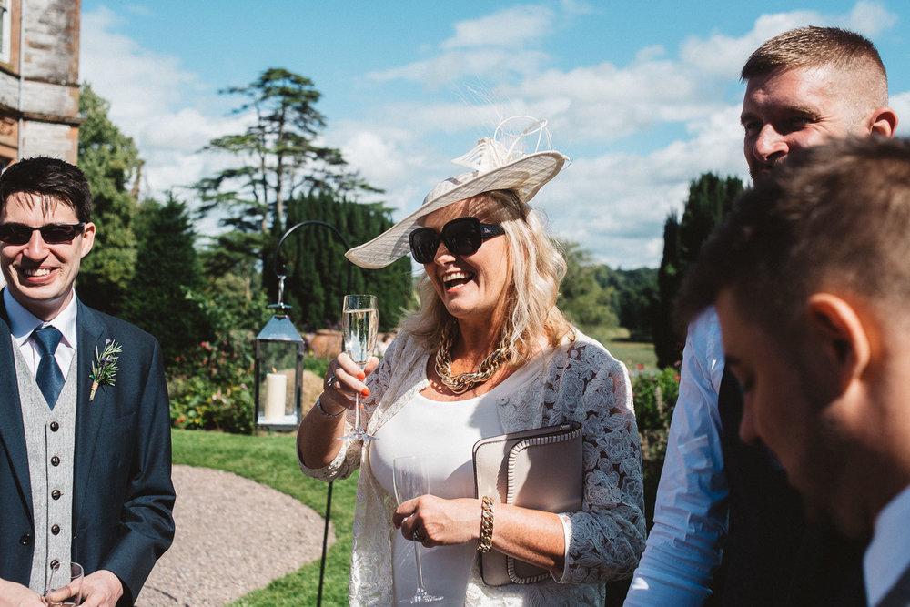wedding guests having a drink at Castle Leslie Wedding.