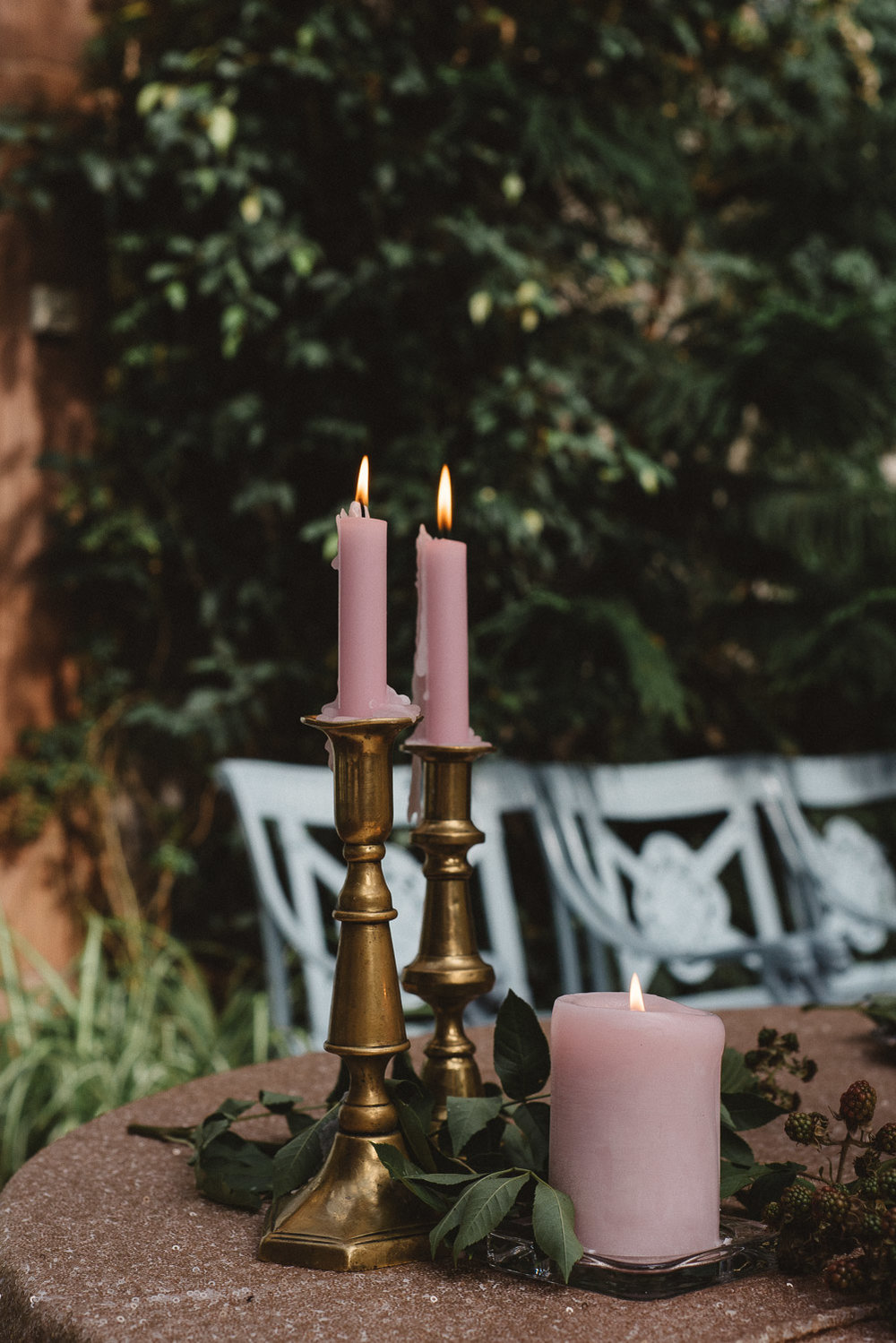 Pink candles in gold candle holders.