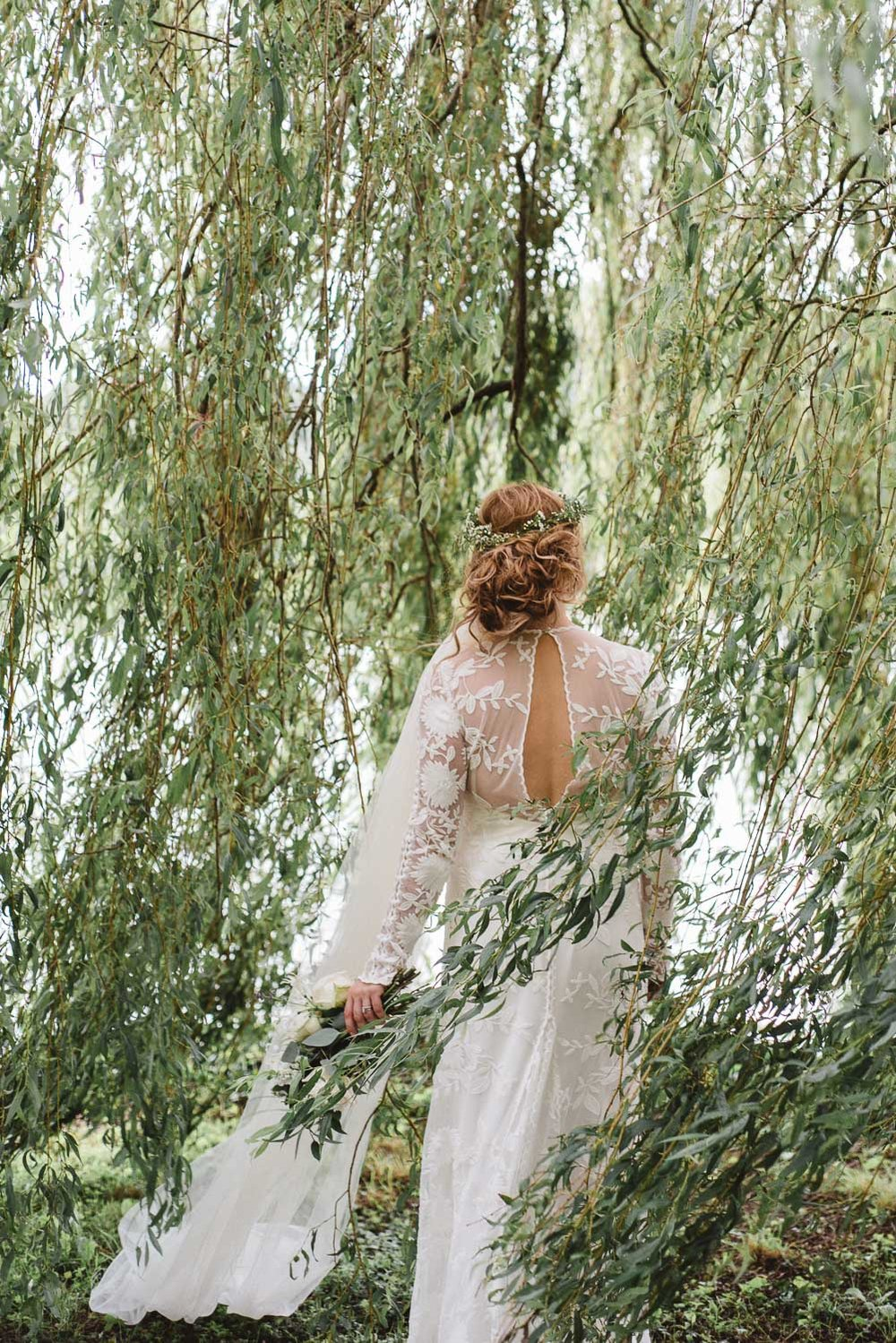 Back of the brides dress under a willow tree at Castle Leslie Wedding.