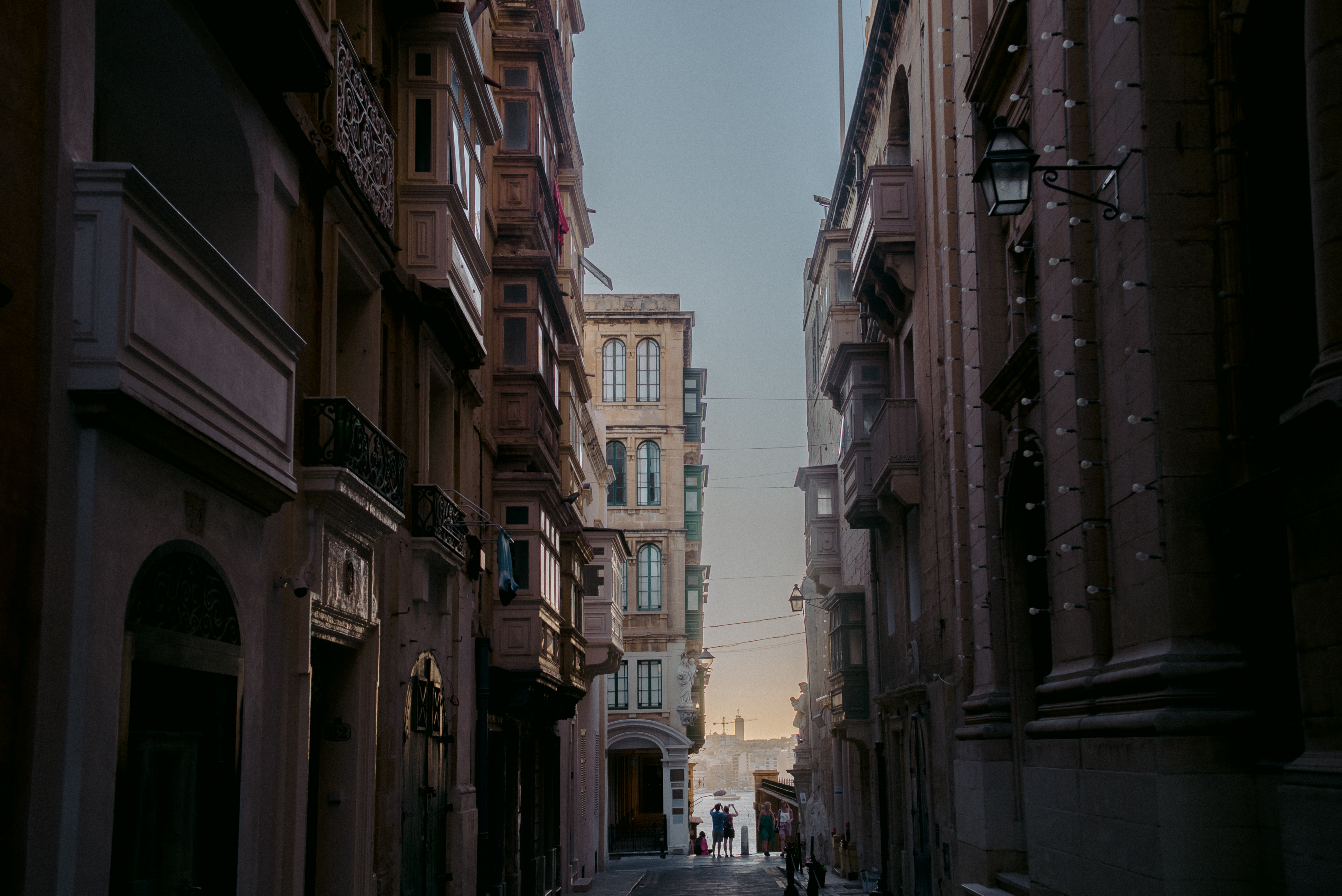View of the ocean down a long street in valetta, malta