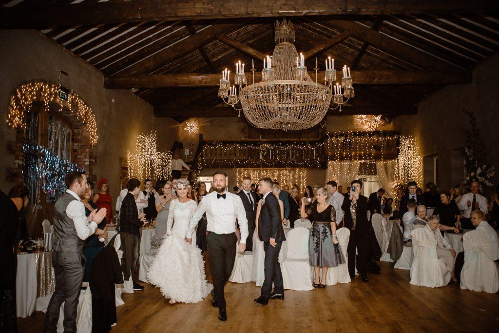 groom leading bide onto dance floor for first dance