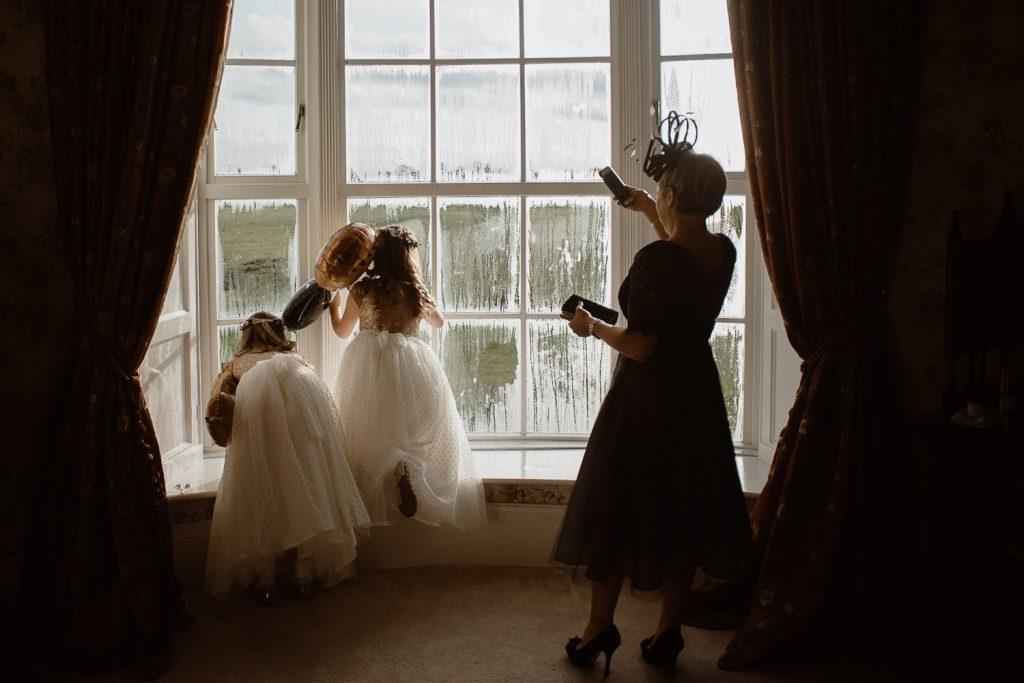 flower girls looking out window