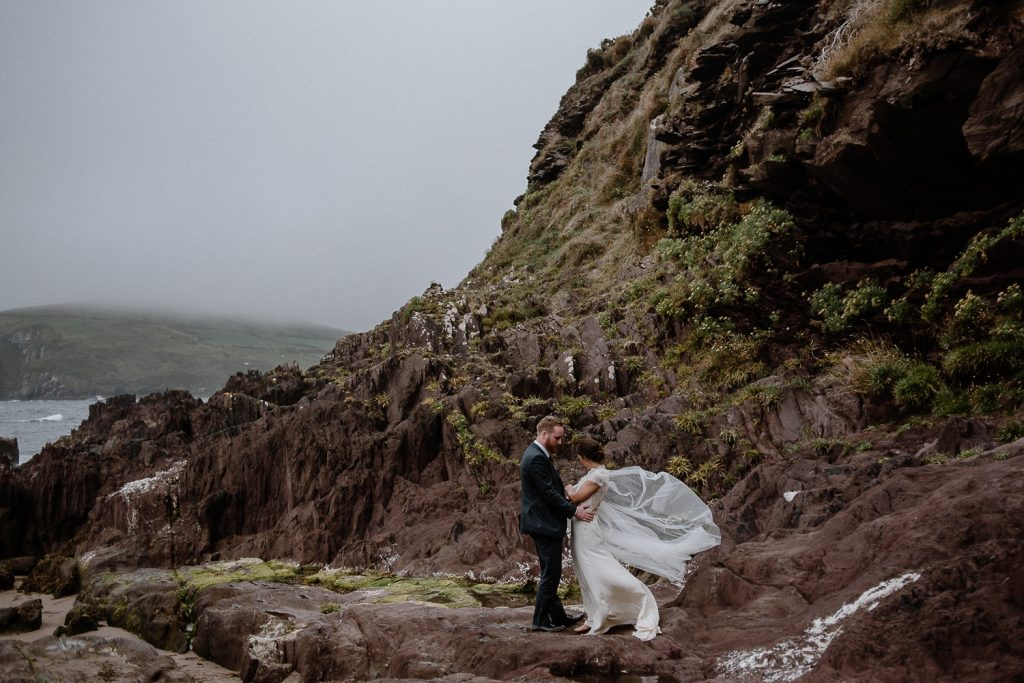 wind blowing brides cape on a beach in ireland