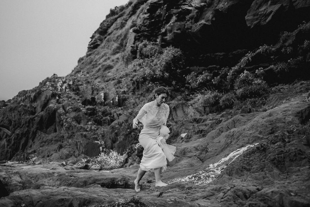 bride walking bare foot on beach