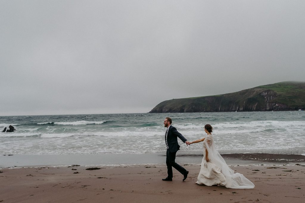 Ballintaggart house wedding. landscape of beach and bride and groom walking by the sea