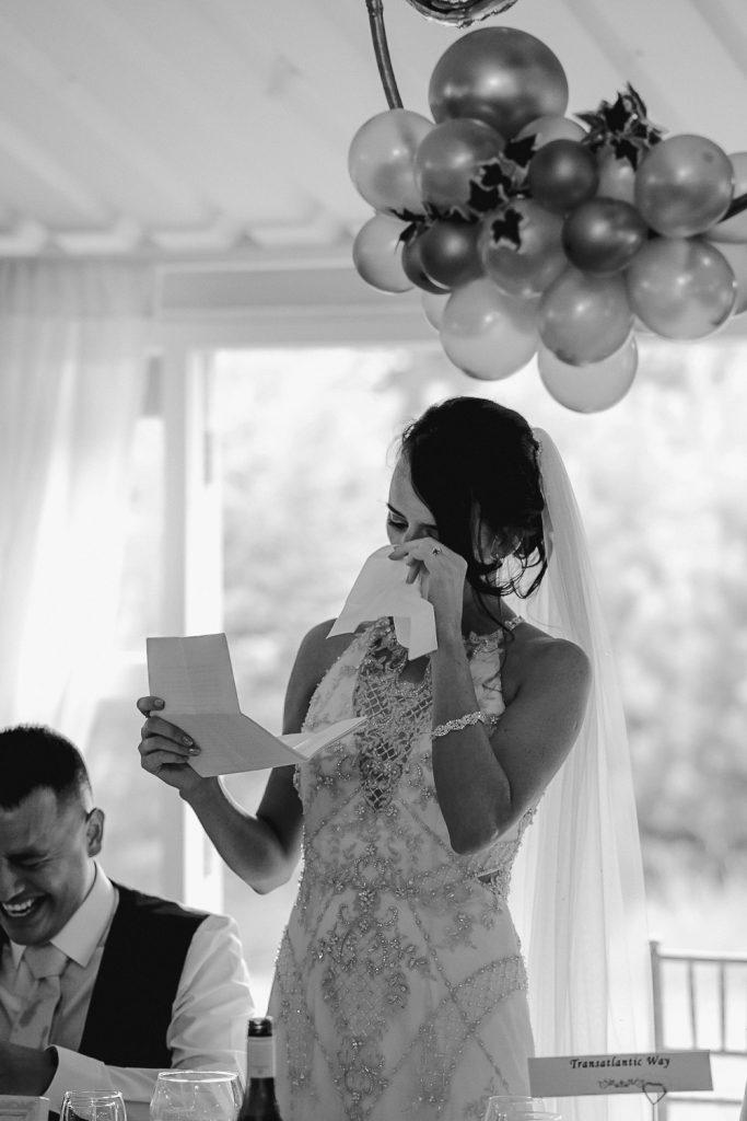 bride wiping away tears as she speaks