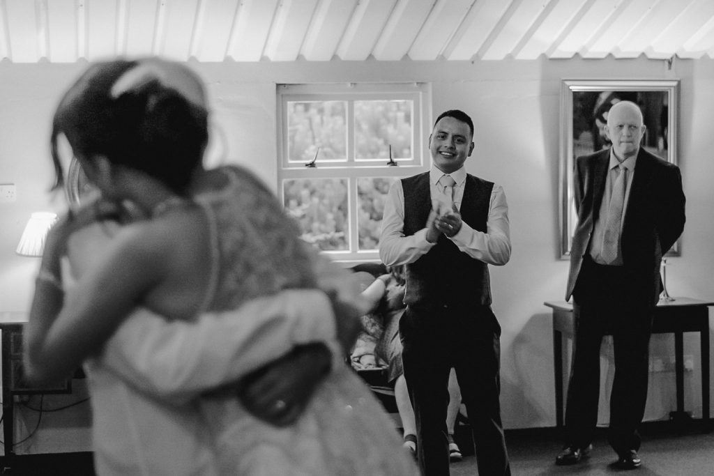 groom gets emotional as he sees hid bride dancing with her father