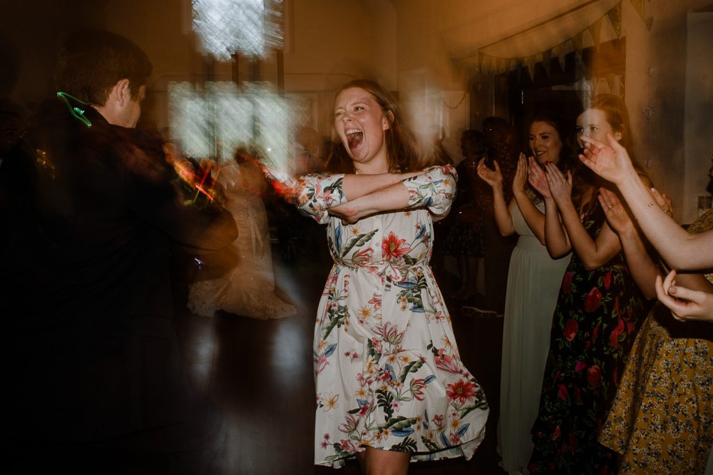 wedding guest dancing and laughing