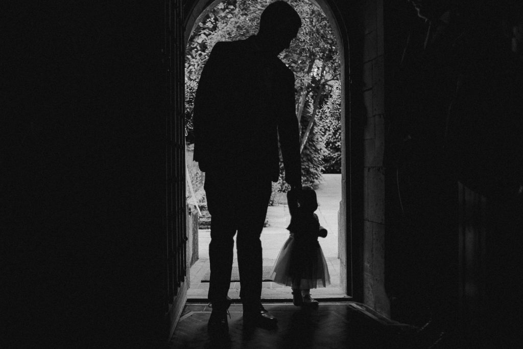 Silhouette of little girl with her father