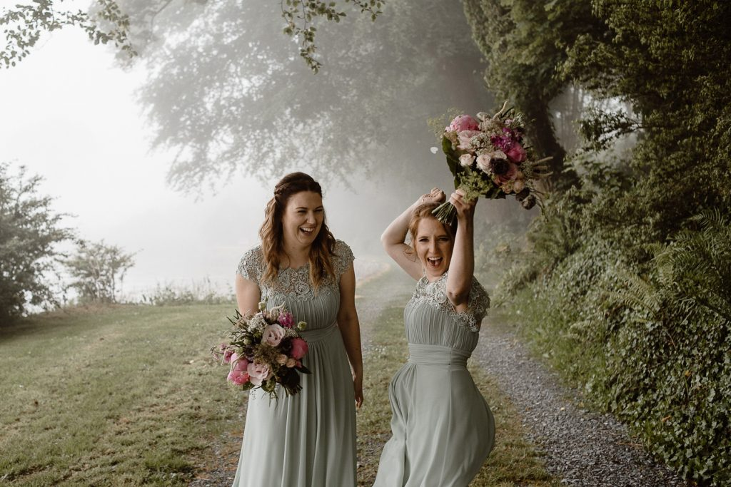 Old court chapel wedding. bridesmaids cheering and having fun