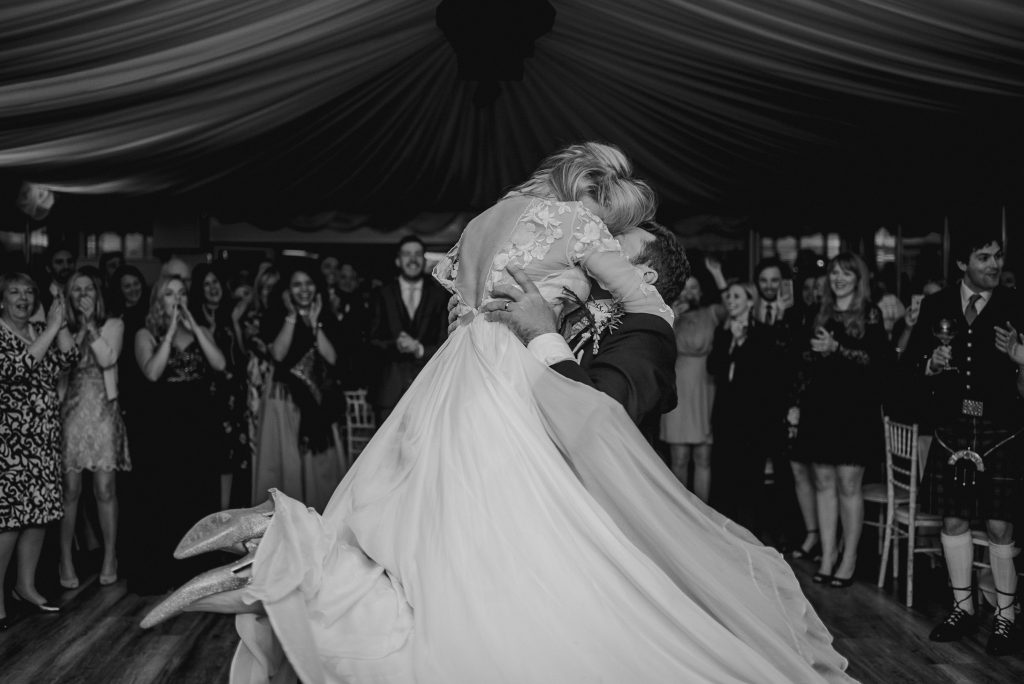 groom spins bride round dance floor