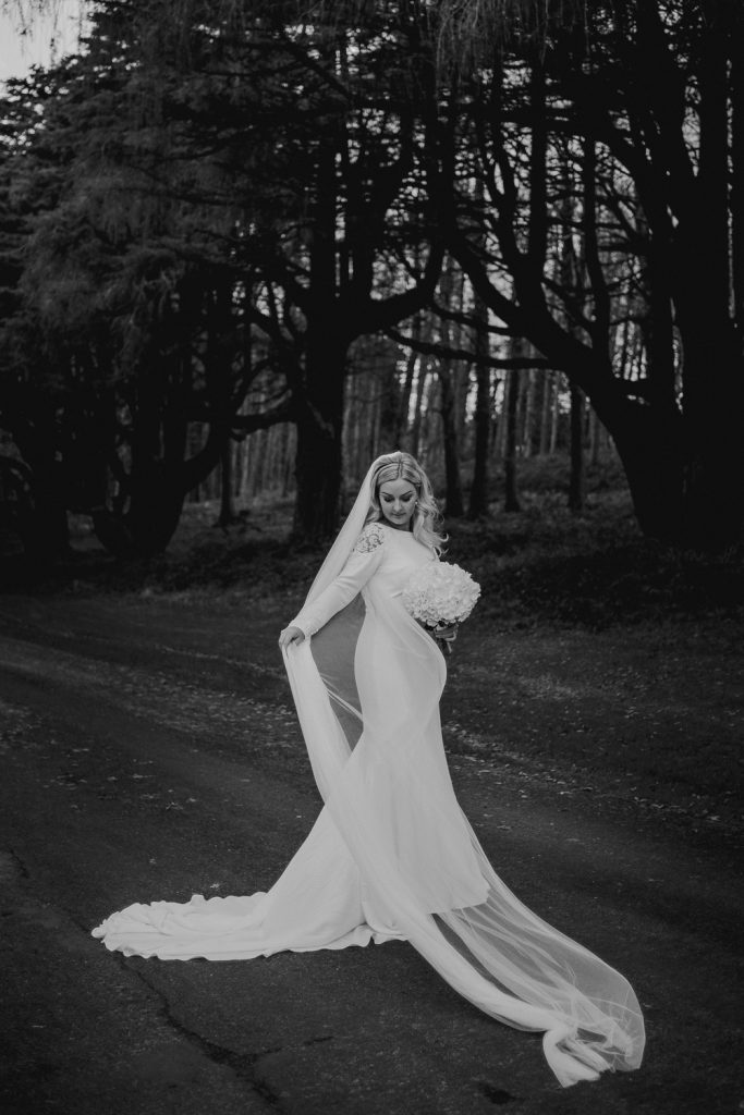 Bride playing veil in the wind