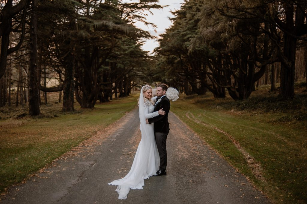 bride and groom in forest together. Slieve donard wedding