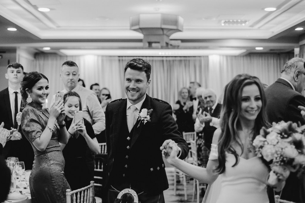 bride and groom celebrating as they are called in the room