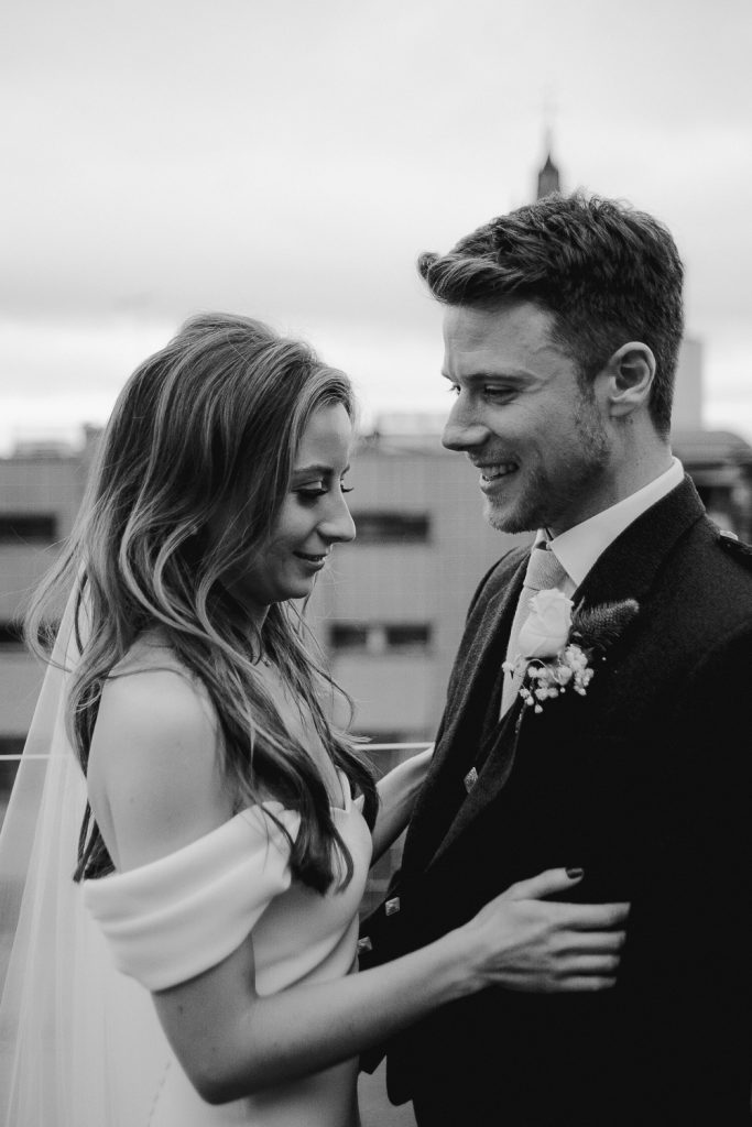 groom smiling towards bride