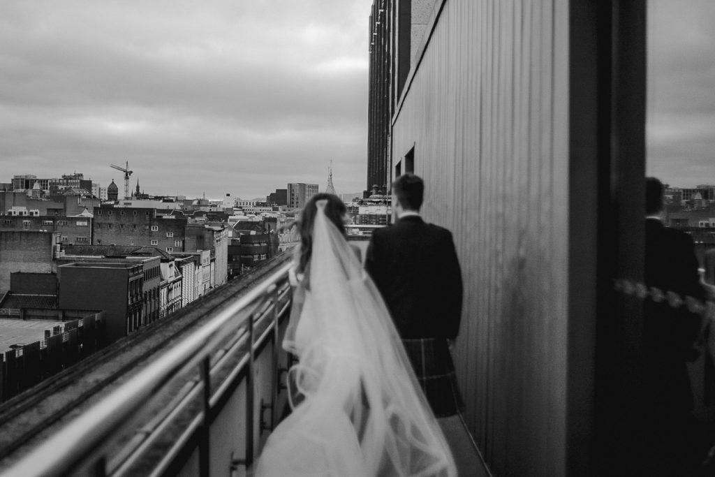 The Merchant wedding. brides veil blowing towards camera