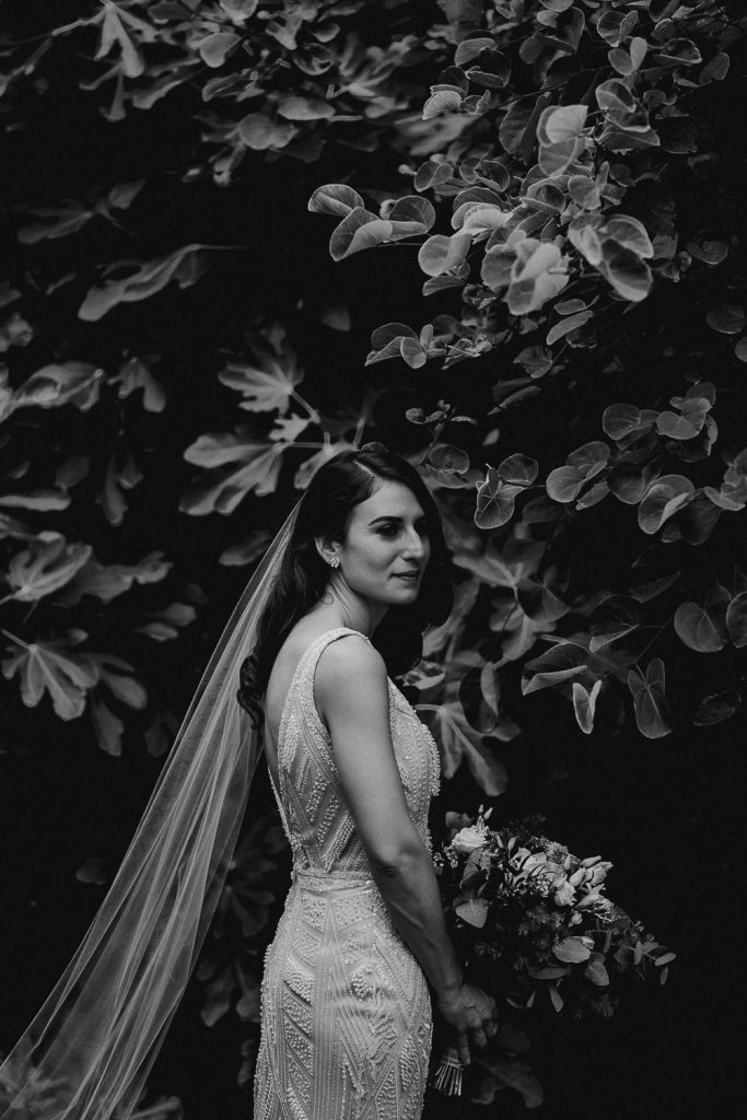 Tankardstown house wedding. bride in beautiful light surrounded by leaves