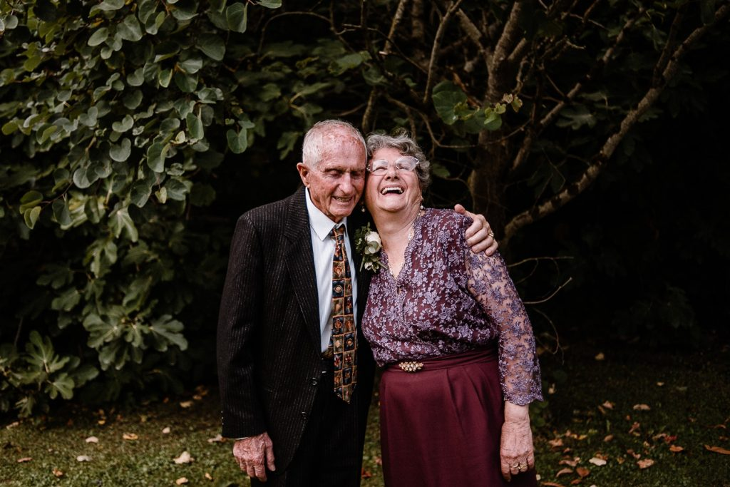 elderly couple, happy and hugging