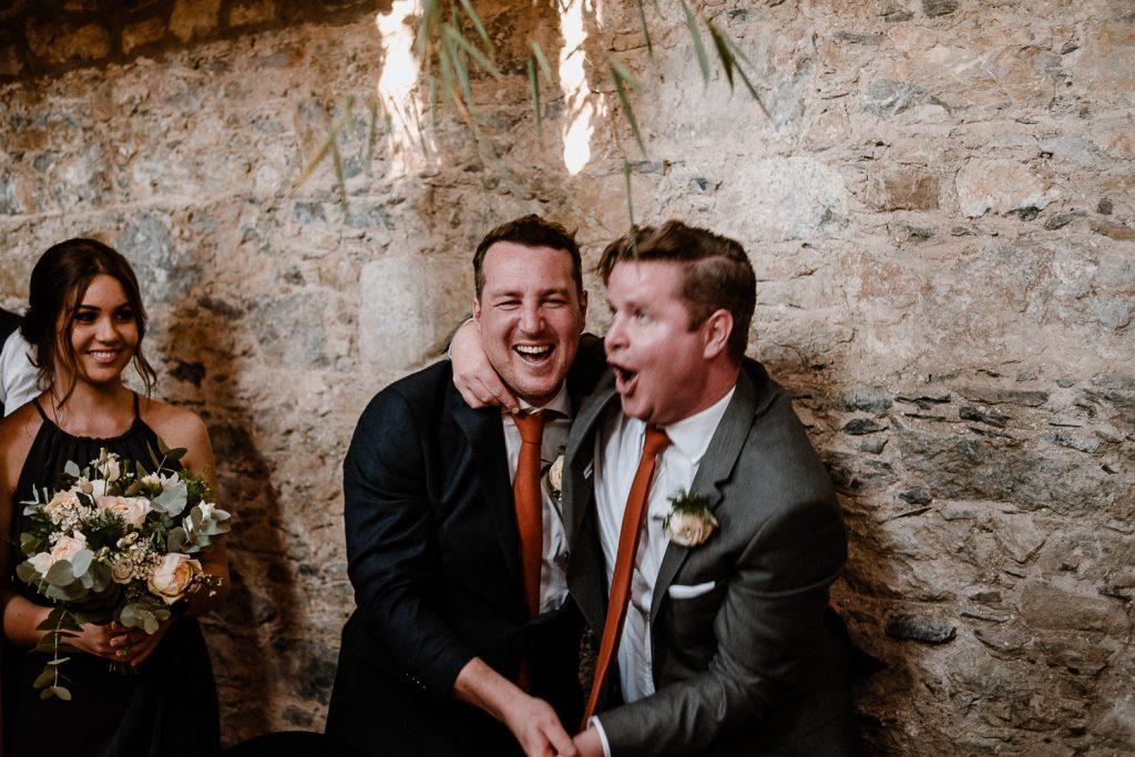 groom and groomsmen cheering