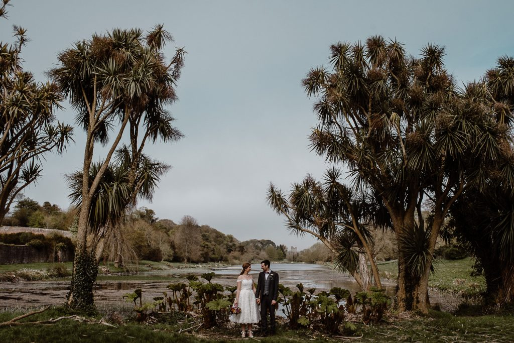 The culloden wedding. Old court chapel wedding tiny bride and groom in front of lake and palm trees