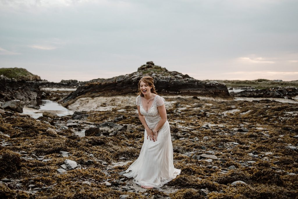 bride laughing on beach