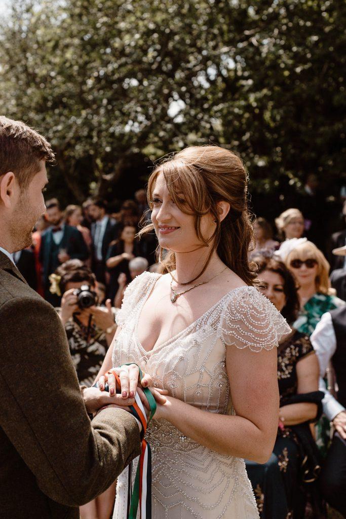 happy bride taking her vows