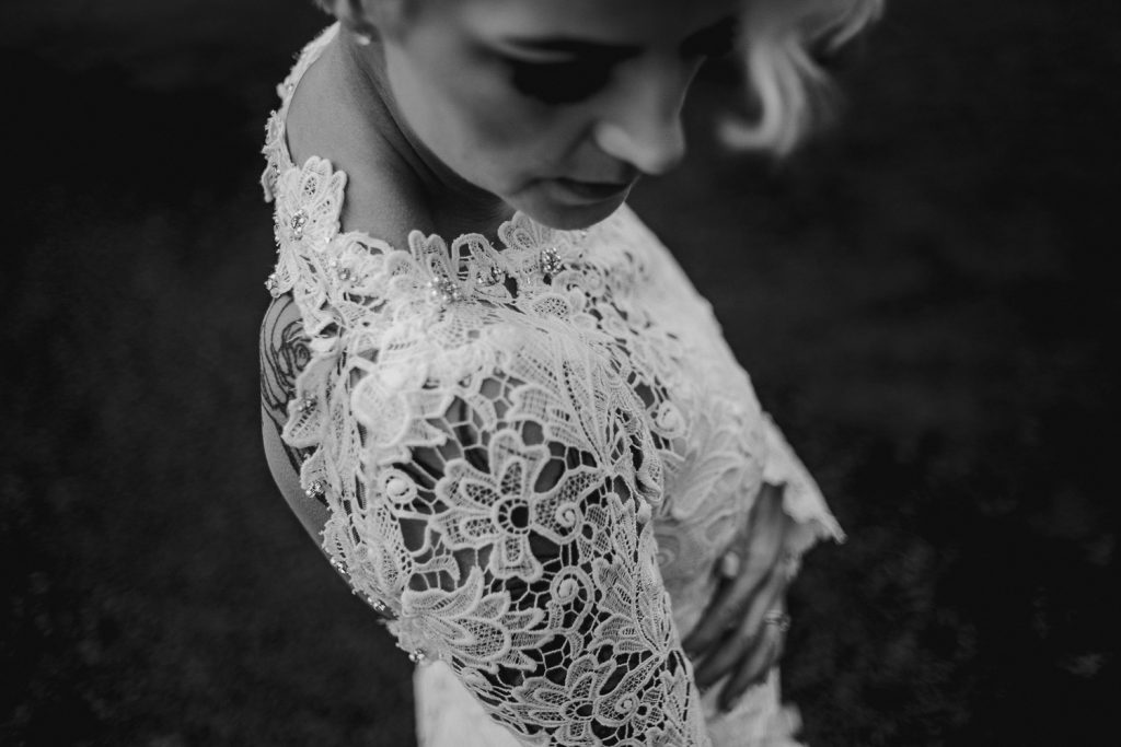 close up of brides lace dress at grace hall wedding