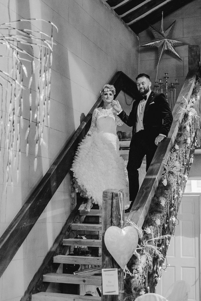 bride and groom walking down the steps at grace hall