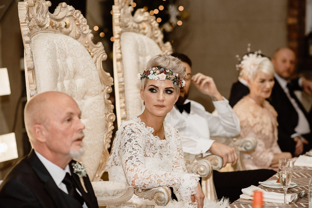 bride listens to father speaking