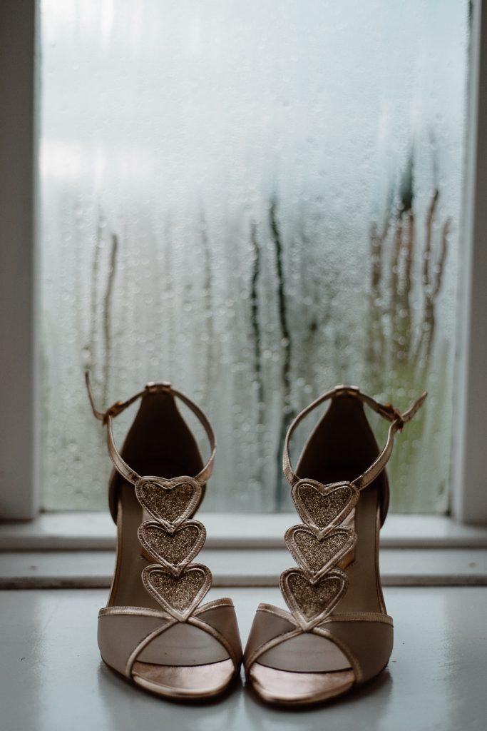 wedding shoes on window