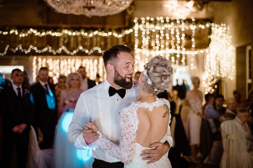 close up of groom dancing