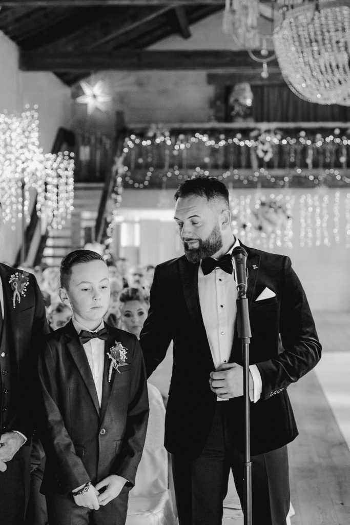 groom smiling at his son