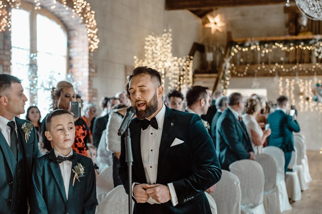 groom continues to sing
