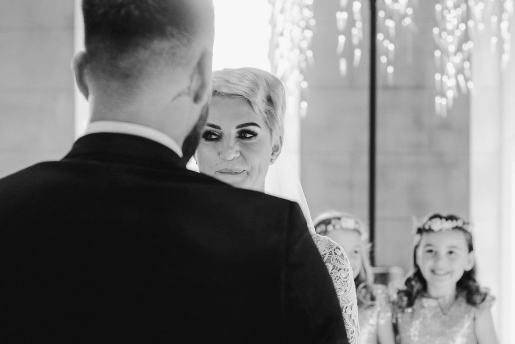 bride bites her lip in nerves