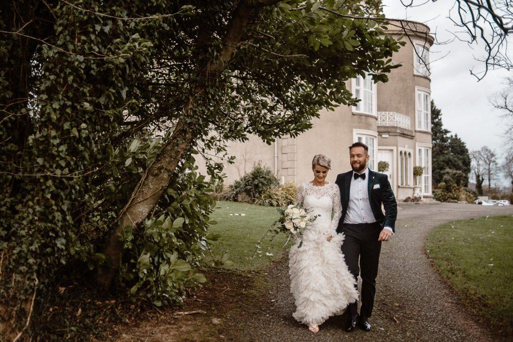 bride and groom walking grace hall wedding