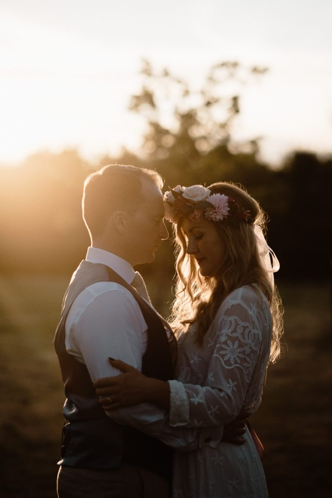 bride and groom portrait in beautiful sunset