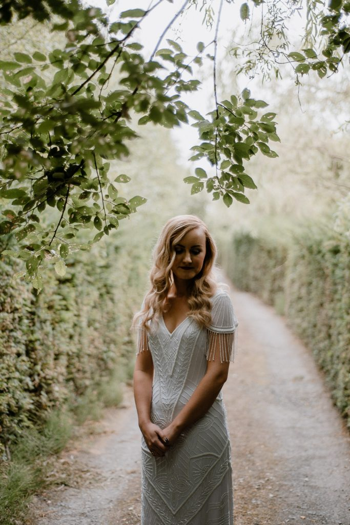 bridal portrait among trees and leaves