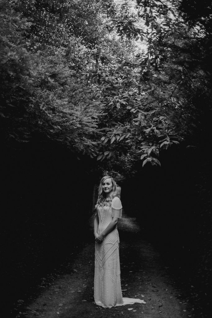 full length portrait of bride standing under trees and beautiful light. mount druid wedding photographer