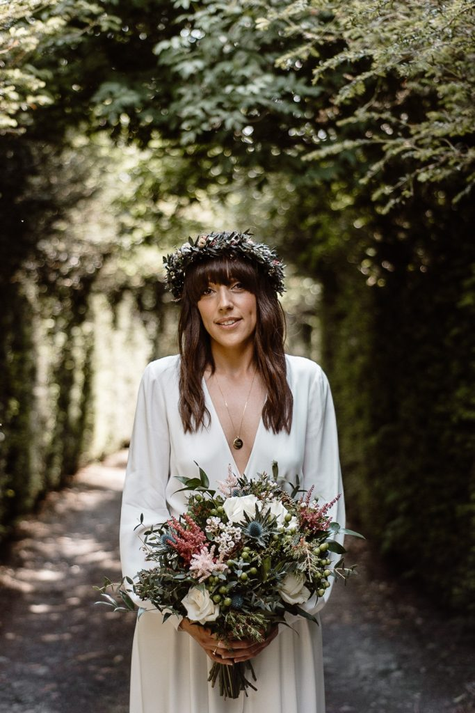 bride portrait holding flowers and wearing flower crown