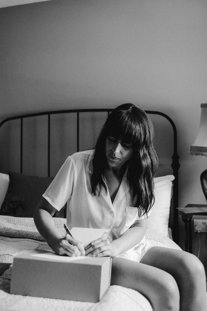 bride writing note on her wedding morning.