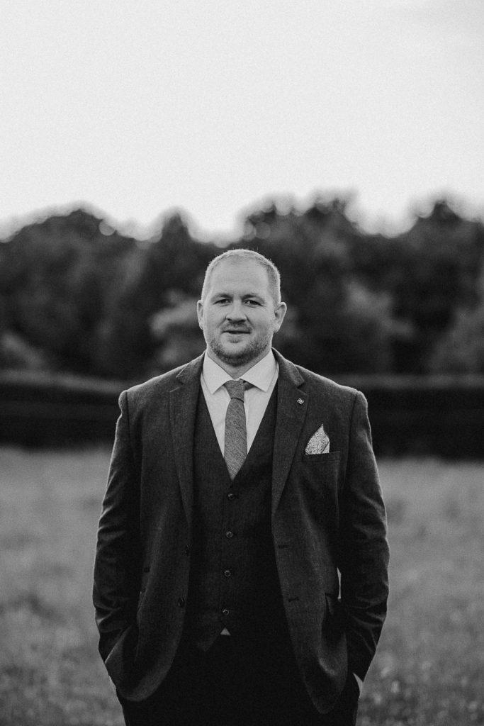 portrait of groom in field