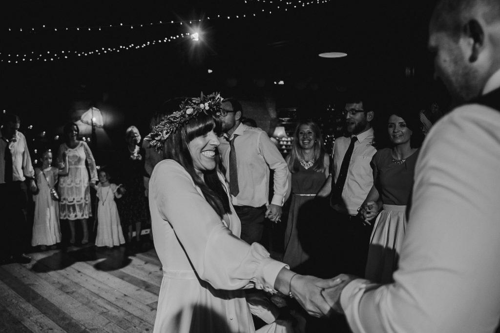 close up of happy bride dancing