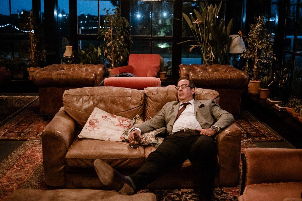 man sleeps on sofa