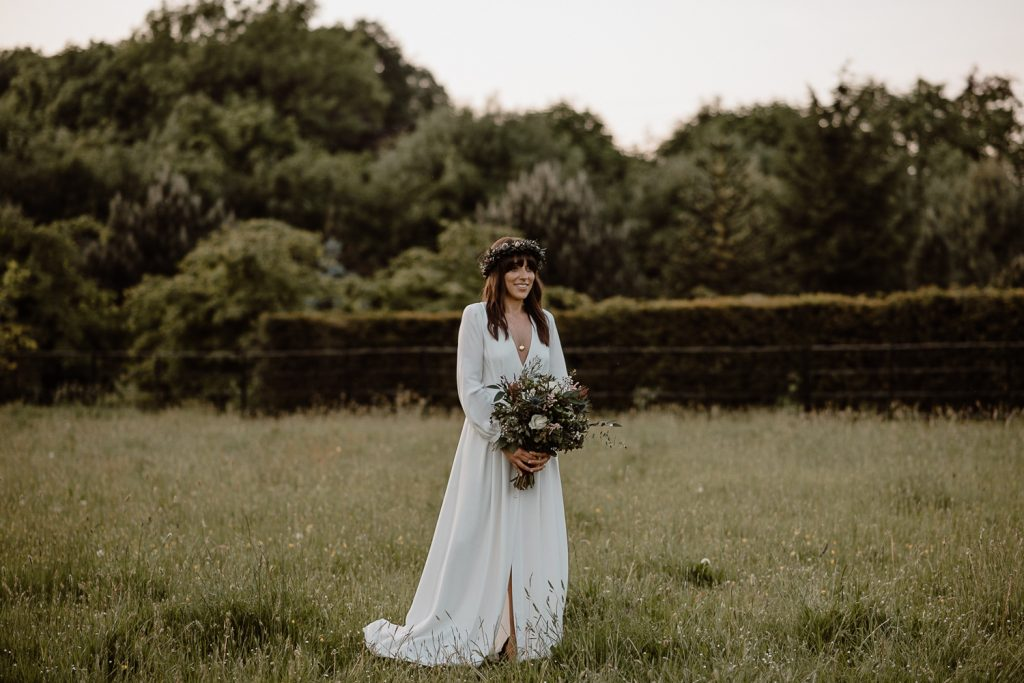full length of bride in field