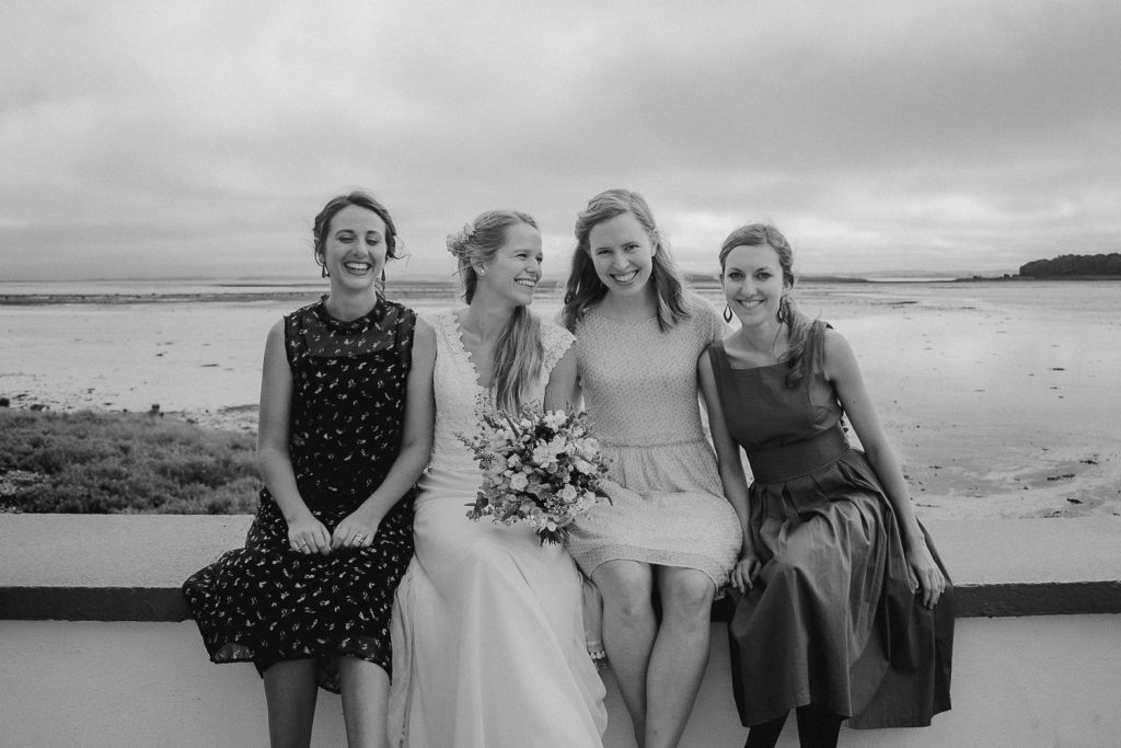 bride sitting with her friends