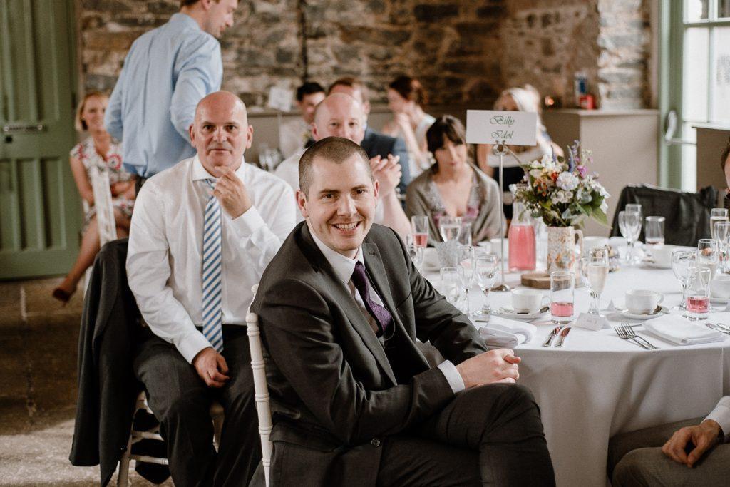 wedding guests enjoying speech