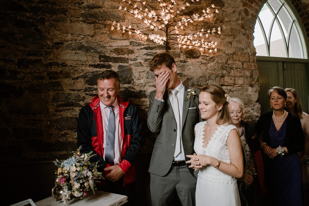 groom laughing at brother