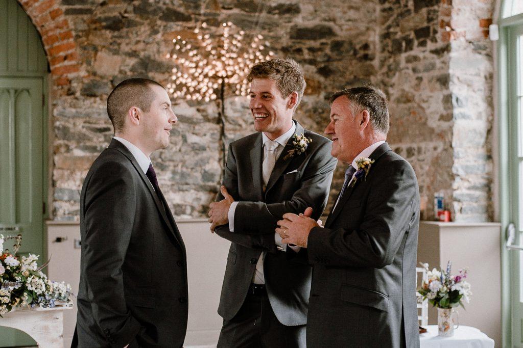 groom taling with groomsmen