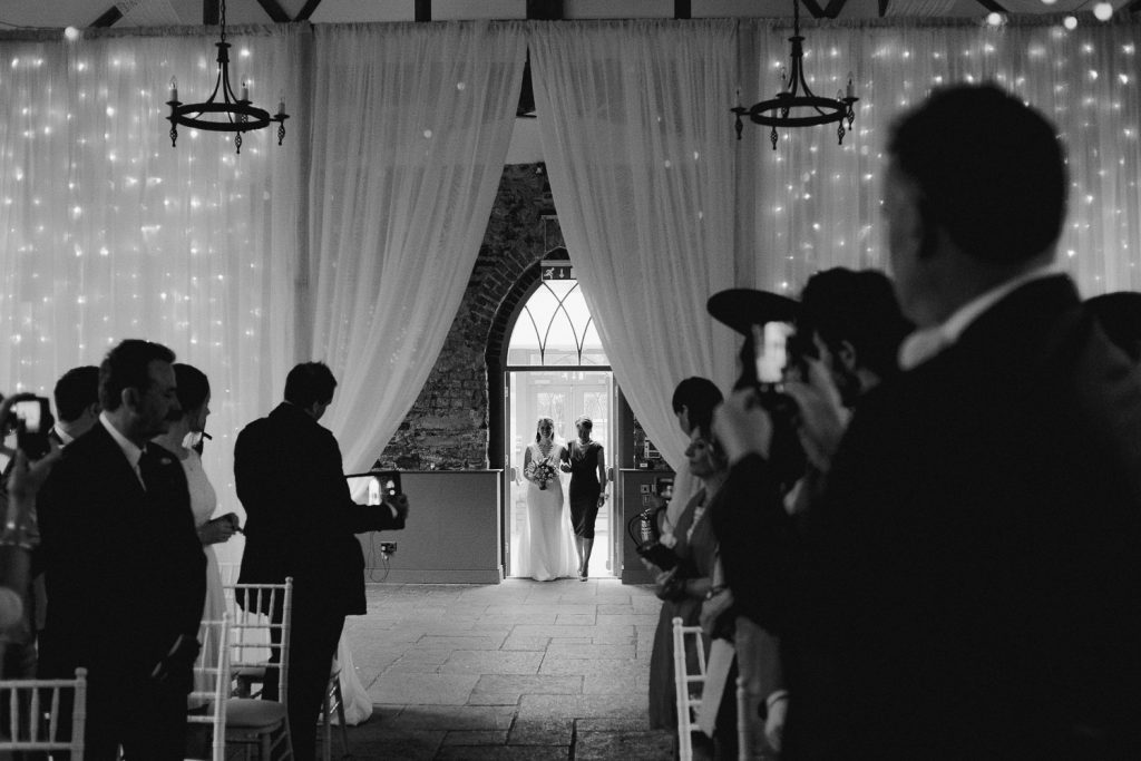 bride enters with her mother to walk up the aisle