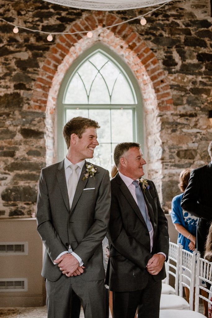 groom looks back to see the bride